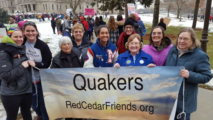 Quaker contingent holding banner at the Lansing Women's March, 2018