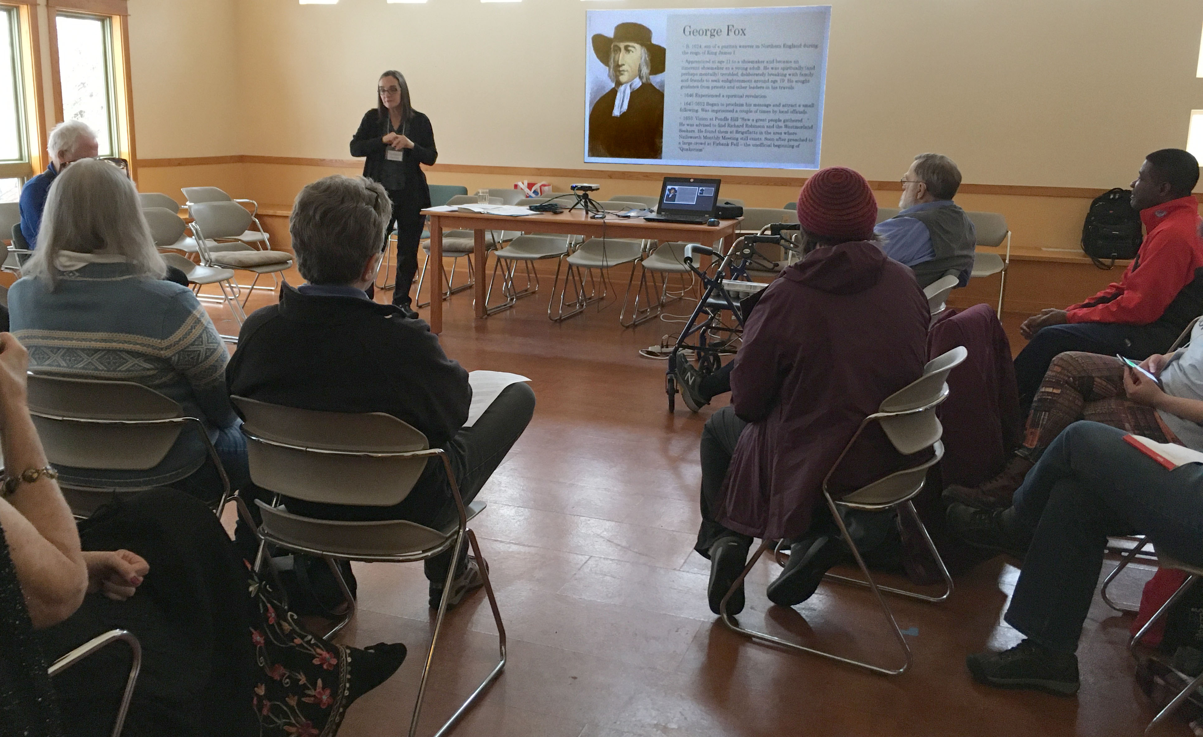 Photo of Stephanie Charlot introducing Quaker history in our first session.